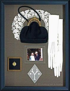 Classy shadowbox with an assortment of memorable objects.