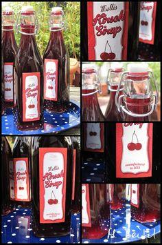 Flaschen mit Kirsch-Sirup