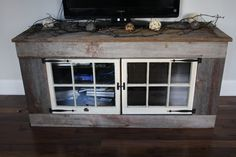 Reclaimed wood TV Stand. $1,200.00, via Etsy.