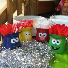 Elmo birthday craft! Red buckets for silverware.