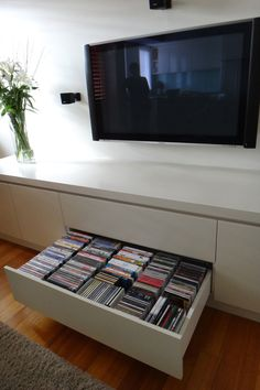 Dvd storage ideas for your precious home 25 Cd Storage, Vinyl Storage, Storage Ideas, Dvd Storage Solutions, Record Storage, Storage Drawers, Media Wall Unit, Basement Movie Room, Wood Entertainment Center