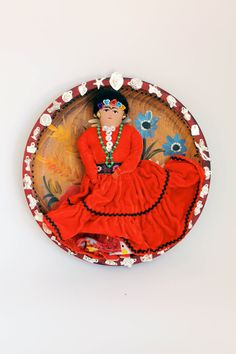 Frida Kahlo Upcycled Altered vintage doll wall decor/ Mexican folk art inspired / Vintage wood plate Batea / art doll with silver milagros. $52.00, via Etsy.