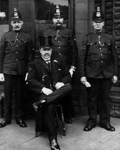 Uniformed officers and a detective of Manchester City Police taken outside their police station in Newton Heath, circa 1880. Detectives of the day liked to dress well and this officer is no exception, looking rather splendid alongside his, somewhat crumpled, uniformed counterparts.    From the collection of www.gmpmuseum.com