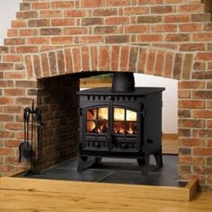 Double Sided Wood Burning Stoves By StoveSellers, Double Sided Wood Burner provide heating solution to two rooms at the same time and can be found in a property like pubs and restaurants, etc Hunter Stoves, Double Sided Stove, Wood Burning Logs, Walnut Wood Texture, Stove Fireplace, Brick Fireplaces, Cabin Fireplace, Farmhouse Fireplace, Fireplace Ideas