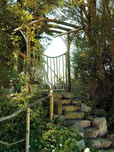 Natural trellis & rail.  Love the stone steps..