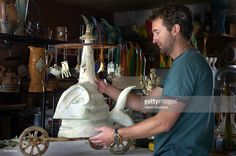 ---AESCENE2--WESTMINSTER, COLORADO, AUGUST 7, 2007-- Artist Todd Redmond works on a sculpture titled 'The Ringmaster' in his Westminster garage studio earlier this week. Redmond, whose body of work features pottery, ceramic tile and free-form mixed-media sculpture, says his latest eclectic art instills a lot of his own personal vision and experience and sheds the typical forms of his past creations. He and over 200 sculptors from around the world will be displaying their art at the 24th…