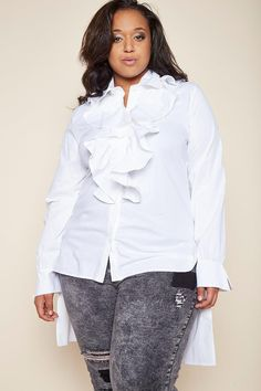 A classic plus size blouse with a unique appearance! Includes button-ups, ruffled details at the front, and a high-low silhouette. Matches perfectly with fitted dress pants and pointy-toed stilettos.