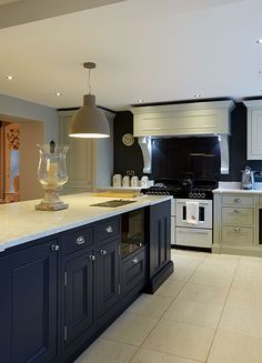 Take a look at one of our traditional kitchens in Horbury, Wakefield. This 1909 kitchen with shaker-style cabinets has a sophisticated and elegant feel Traditional Kitchen Inspiration, Traditional Kitchens, Shaker Style Cabinets, Kitchen Cabinets, Blue Shaker Kitchen, Kitchen Mantle, Elegant Kitchens, Wakefield, Aga