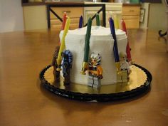 """Star Wars Birthday Party cake with lego jedi- cake topper for my daughter's cake- worked great because the jedi & """"lightsabers"""" stuck to the side of the cake & did not move."""
