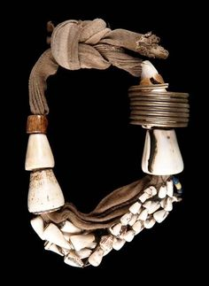 Belt from the Bontoc people of the Cagayan valley | Cotton, conus shell and brass. Philippines ~ Ifugao |