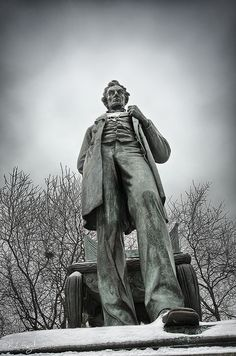 Abraham Lincoln: The Man (also called Standing Lincoln) is a bronze statue of Abraham Lincoln, the 16th president of the United States. Completed by Augustus Saint-Gaudens in 1887, it has been described as the most important sculpture of Lincoln from the 19th century. The original stands behind the Chicago History Museum in Lincoln Park. Photo by rjseg1, via Flickr