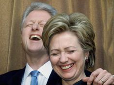 Clintons Have Three Cayman Island Accounts From Bloomberg: Ron Burkle, managing partner and founder of Yucaipa Cos., left, and former President Bill Clinton, right, stand side by side during the 2n…
