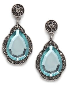 Indian exoticism meets the marine life in these glamorous earrings, which feature a vivid aqua gemstone framed in a teardrop shape reminiscent of the Taj Mahal.  - Perfect for a BRIDE (something blue!)