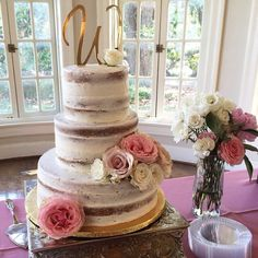 This 3 Tier semi naked cake is absolutely beautiful with the Gold topper and the fresh flowers! This cake serves 95