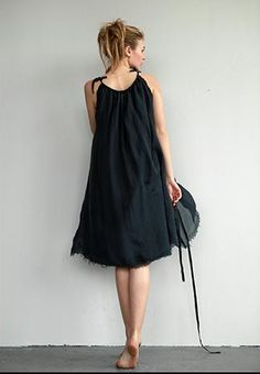 pillowcase dress, cinched at empire waist with detailing or small belt?