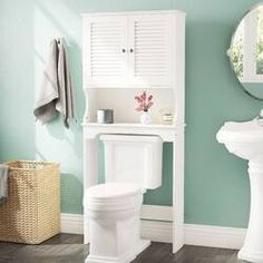 Latitude Run® Jordane 34'' W x 38.5'' H x 7'' D Over-The-Toilet Storage & Reviews | Wayfair Bathroom Standing Cabinet, Wall Mounted Bathroom Cabinets, Laundry In Bathroom, Bathroom Shelves, Bathroom Storage, Toilet Shelves, Small Bathroom, Bathroom Ideas, Bathroom Beadboard