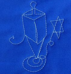 This Dreidel Free Motion Quilt is the perfect way to showcase the spinning movement of a dreidel.