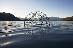 """Interwoven World~For over 20 years environmental artist and photographer Martin Hill has been creating temporary sculptures from ice, stone, and organic materials that reflect nature's cyclical system. Often working with his longtime partner Philippa Jones, the duo create sculptures and other installations that """"metaphorically express concern for the interconnectedness of all living systems."""