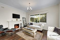 Mix of modern and classic furniture.  Living room ideas.  Photography by CT Creative.