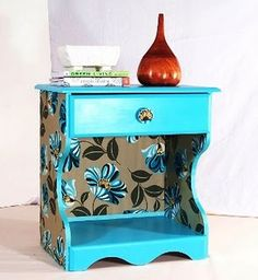 Nightstand makeover using paint and fabric. Not sure if I'd use fabric, but I definitely like this look.