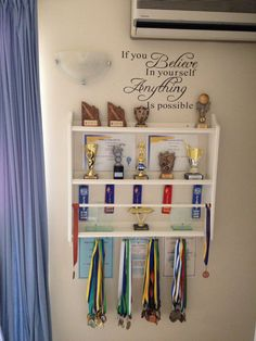 Trophy display using a plate shelf from IKEA. Needed somewhere to store and disp. Trophy display using a plate shelf from IKEA. Needed somewhere to store and display my sons achieve Diy Trophy, Trophy Shelf, Trophy Display, Award Display, Plate Shelves, Display Shelves, Display Ideas, Trophy Cabinets, Ribbon Display