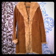 Wilsons Leather Suede Shearling Coat This suede coat is the softest and warmest! Faux fur lines the length of the coat. A few minor spots from normal use are on the outer suede but can easily be cleaned with suede cleaner. There's no stains. Wilsons Leather Jackets & Coats
