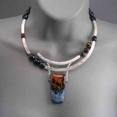 Necklace | Wolfgang Vaatz.  Sterling silver and hand cut semi precious stones.