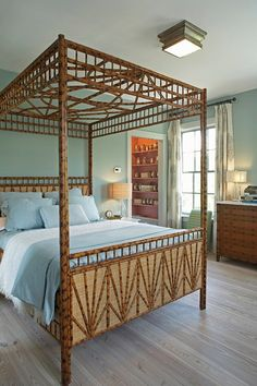 Things We Love: Bamboo - Design Chic - completely obsessed with this bamboo canopy bed - perfect for the master bedroom at the beach - great blue and white!