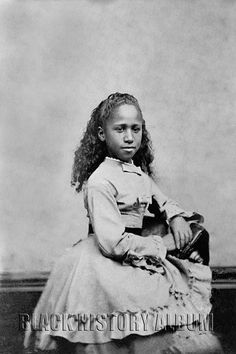 Martha | 1898 Portrait of African American girl, seated. Hand-colored tintype, c. 1898