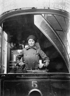 WOMEN FIRST WORLD WAR (Q 31032)   Industry, Transport and Agriculture: A woman tram driver, wearing a beret and uniform coat for London Corporation Transport, at the controls.