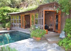 'Charlie's Angels' Lucy Liu Is Selling Los Angeles Zen Craftsman House Lucy Liu, Bungalow Landscaping, Zen, Craftsman Home Interiors, Large Chair, California Bungalow, Dark Wood Cabinets, Oak Trim, Pool Cabana