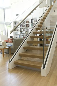 Glass and stainless steel systems are designed through our custom staircase…