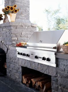 Stone outdoor fireplace and built-in grill