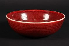 BROTHER THOMAS POTTERY - Low Ribbed Bowl in red copper glaze. Signed and with collector's marks. 3 1/4