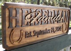 """This is a beautiful personalized rustic family sign. This plaque is a great personalized family name sign for a country wedding or an anniversary gift for the farmer or horse loving couple, sending good luck with the horseshoes theme. The family's last name is the centerpiece in all caps and the word """"Family"""" is in fancy script layered on top, making the sign have a true 3D feature. There are single 3D horseshoes adorning each side. **SHIPS IN APPROXIMATELY 14-17 DAYS**"""