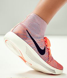 FLUID FEEL // The Nike LunarEpic Flyknit Women's Running Shoe has laser-cut lines built to compress on impact, delivering a smooth transition from heel to toe.