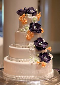 Orange and purple flower wedding cake