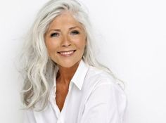 Older women with long hair; the beauty of the look is the fact that this smart lady has not fallen for the hype that grey/white/silver hair makes you look old - these colors are the most beautiful hair colors of all and well worth waiting for... by caitlin
