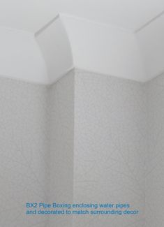 BX2 Square Corner Pipe Boxing covering vertical water pipes.  Decorated to match surrounding decor.