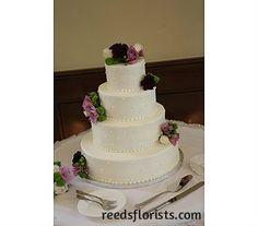 Fresh flowers ensure that our bride's cake co-ordinates with her colour scheme perfectly. reedsflorists.com Brides Cake, Cake & Co, Fresh Flowers, Color Schemes, Floral Design, Wedding Decorations, Reception, Colour, Elegant