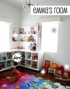 Lovely kid's room! Love the corner shelves. :)