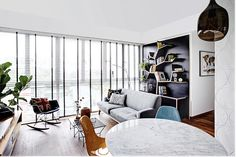 How to do industrial, retro and contemporary all at once Basic white, black and wood tones form the base of this condo apartment in Bedok, which is furnished with colourful and statement pieces. Flat Interior Design, Interior Design Website, Contemporary Interior Design, Modern Interior, Rooms Home Decor, Living Room Interior, Living Rooms, Small Space Living Room, Small Spaces