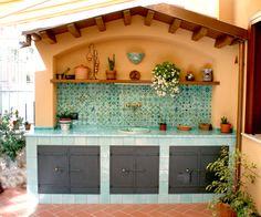 Cucina in muratura con piastrelle in terracotta e top in - Cucina muratura esterna ...
