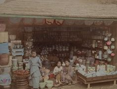 Porcelain and pottery shops. Hand colored photographs capture Japanese life during the Meiji Period, 1890, taken by Japanese photographer, Kusakabe Kimbei.