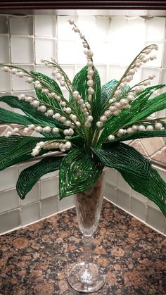 . French Beaded Lily of the Valley.  This listing is for French Beaded Lilly of the Valley Bouquet -- 15 stems of Lily of the Valley (each stem contains 7-13 little flowers) with 17 leaves stems (Size Vary in Different Finished Beads) arrange in Crystal Glass Champagne Flutes. .FREE SHIPPING Create an all year run cheerful atmosphere in your home. Perfect for your dining table center piece, window garden, home decor!  ** Please note: These Lily of the Valley Bouquet shown in pictures are…