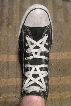 Black Converse hi-tops with white trim and white Pentagram Lacing (from Zachariah K). Both a regular and an inverted Pentagram squeezed into one shoe.