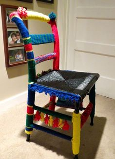 """From fan Ellen Herman Campbell: """"My first yarn bomb, a chair knit up with Red Heart Yarn."""""""