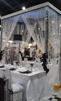 crystal strands ~~ over black and white themed table -  Now this makes me go WOW!!! This is just beautiful. I would switch the black colors to match the season or event.