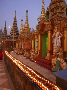 The 'night-lights' at the Shwedagon Pagoda, Yangon (Rangoon), Myanmar (Burma) in full burn. The heat coming off them was quite amazing! #ShwedagonPagoda #religion #Buddhist #Buddhism #Pagoda #Yangon #Rangoon #Myanmar #Burma #SEAsia #Traveling #Travelling #Wandering #Wanderer #travel #travelblogger #travelphotography #wanderlust #NicksWanderings #everybodystreet #lensculture #streettog