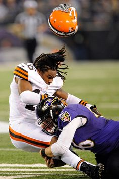 Josh Cribbs, Cleveland Browns, loses his helmet after a hit from Morgan Cox, Baltimore Ravens